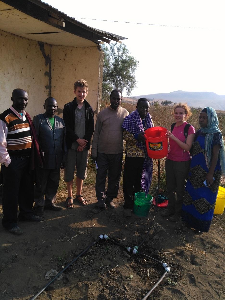 St Hilda's undergraduate, Kirsty Gouck, demonstrating the drip kit for the school committee in Oldonyosambu Ward, Tanzania