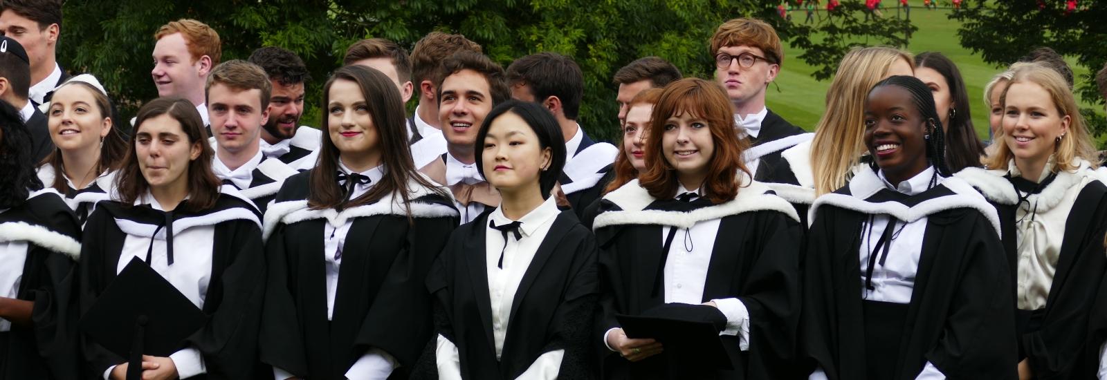 New graduates following their graduation ceremony