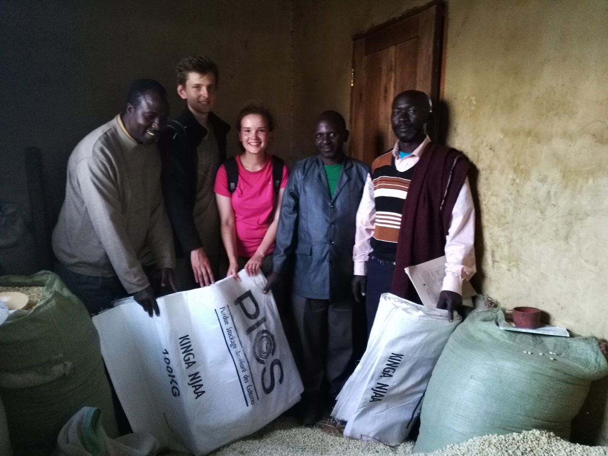 St Hilda's undergraduate, Kirsty Gouck, delivers PICS bags to the school committee in Oldonyosambu Ward, Tanzania