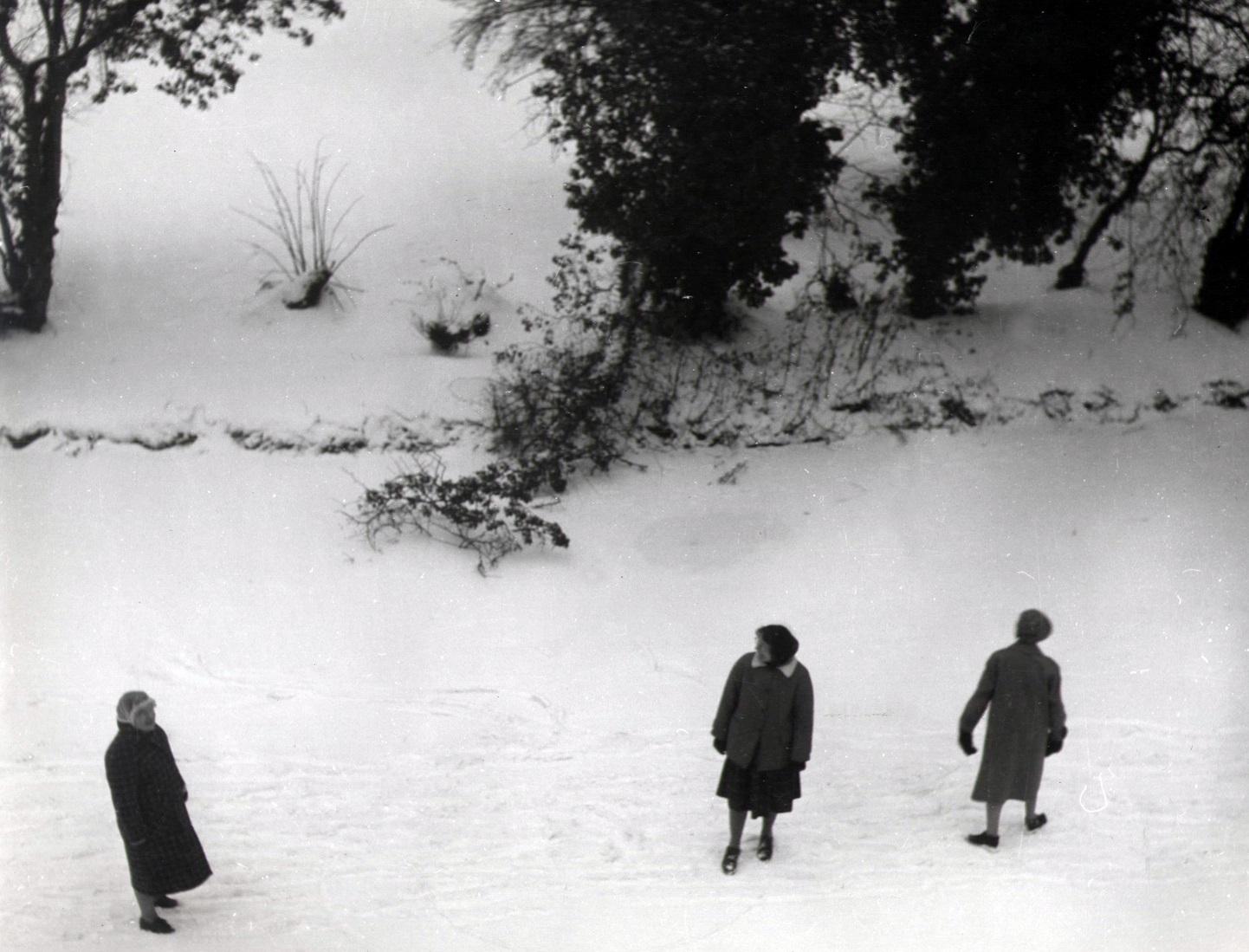 St Hilda's Fellows walking on the frozen river Cherwell, c 1963