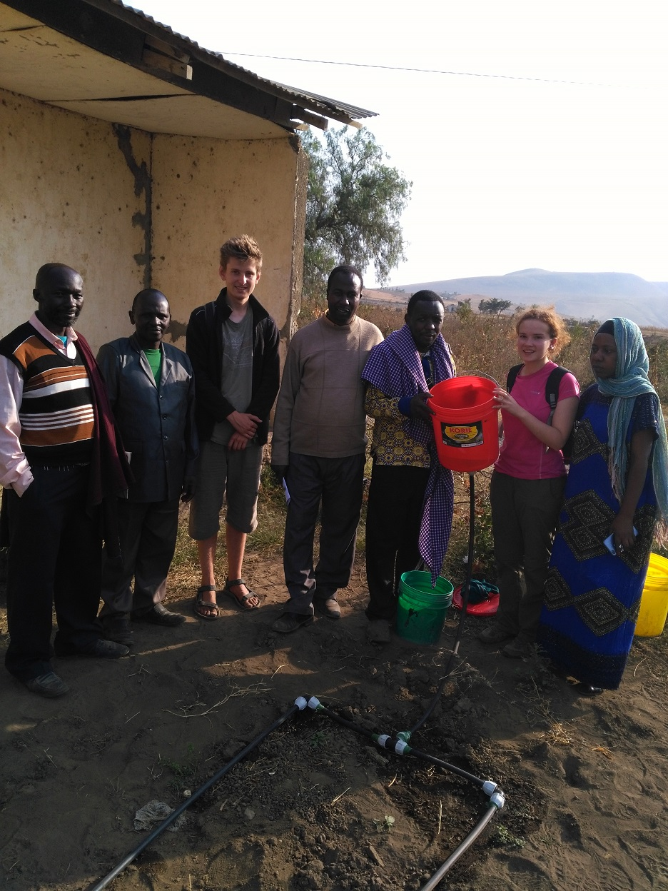 St Hilda's undergraduate, Kirsty Gouck, demonstrating the drip kit for the school committee in Oldonyosambu Ward, Tanzania
