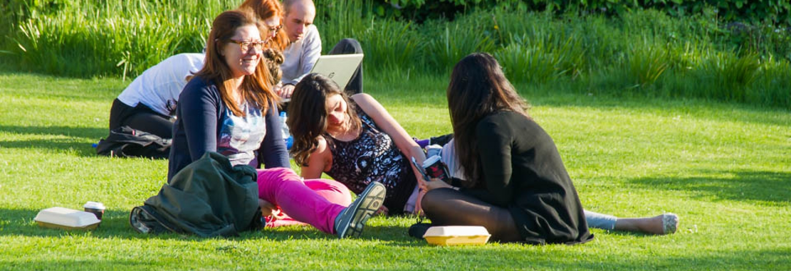 Students relaxing in St Hilda's College gardens