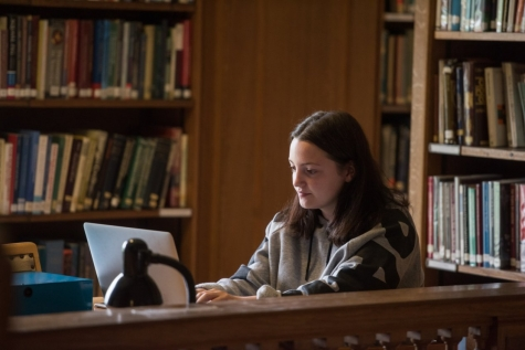 A student studying in St Hilda's Library