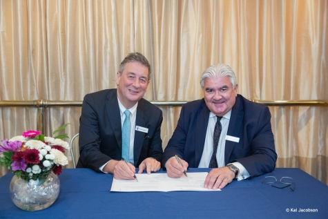 Dr Dermot Kelleher, Dean of the UBC Faculty of Medicine, and Sir Gordon Duff, Principal of St Hilda's College sign a MOU