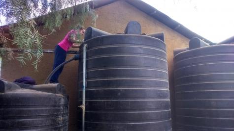 St Hilda's undergraduate, Kirsty Gouck, studying Oldonyosambu village spring water source inlet point at the school