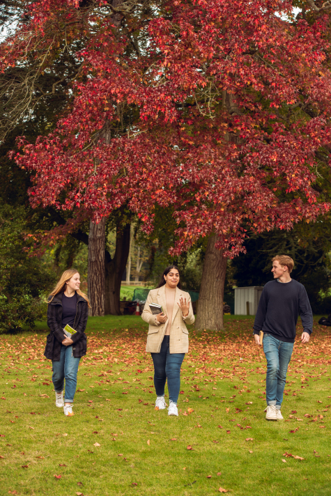 Students enjoying autumn colour in St Hilda's College grounds