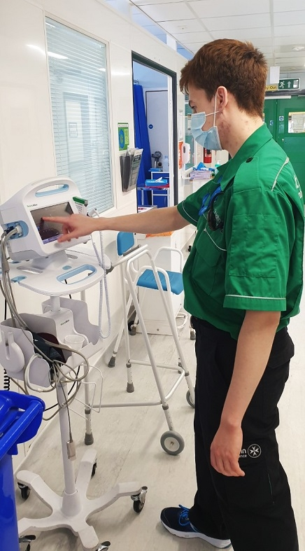 J.P Ay works an observation machine while wearing his St John's Ambulance uniform