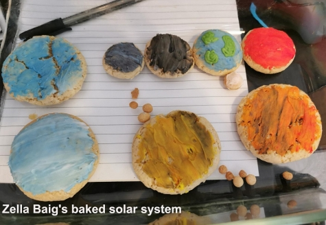 Home-baked biscuit version of the solar system by Zella Baig