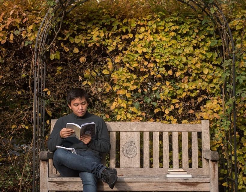 Reading in St Hilda's Rose Garden