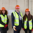 MCR President, Amanda Lyon, Principal, Professor Sir Gordon Duff, and JCR President, Georgina Findlay at St Hilda's topping out ceremony