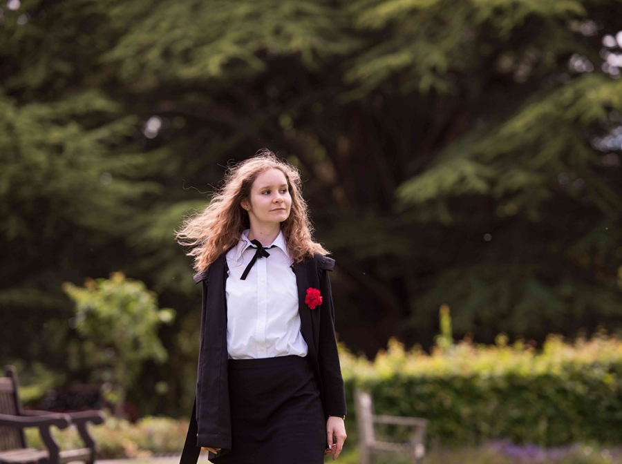 Final year student in St Hilda's College grounds