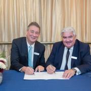 Dr Dermot Kelleher, Dean of the UBC Faculty of Medicine, and Sir Gordon Duff, Principal of St Hilda's College, sign the MOU