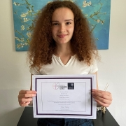 Kirsty Gouck wins the Department of Engineering Science's award for Best Overall Poster