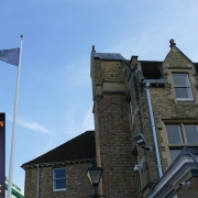 Flying the Oxford Women's Suffrage Flag at St Hilda's College, University of Oxford