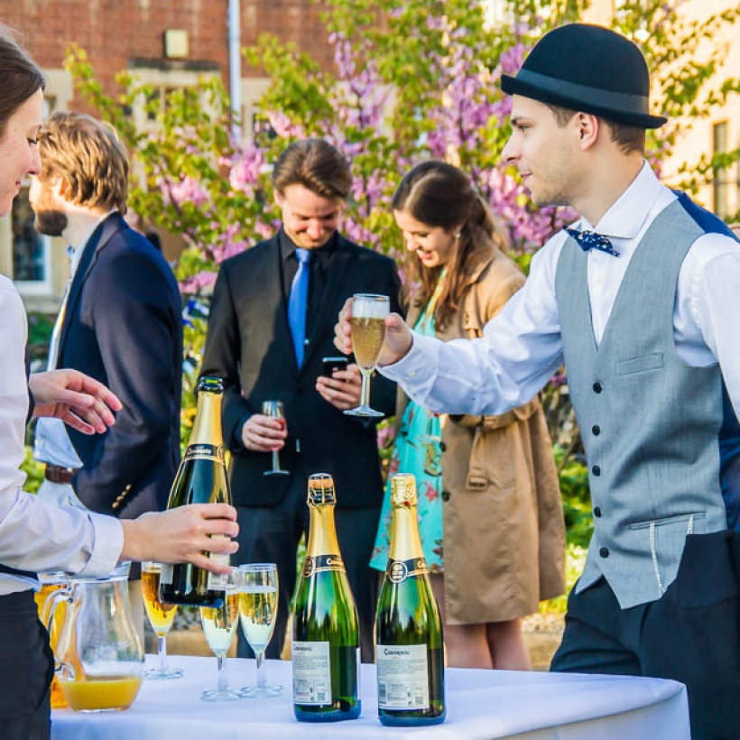 Guests having drinks on the lawn, St Hilda's College