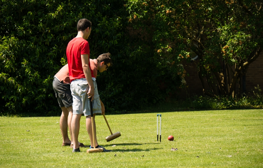 Students playing croquet on St Hilda's lawn