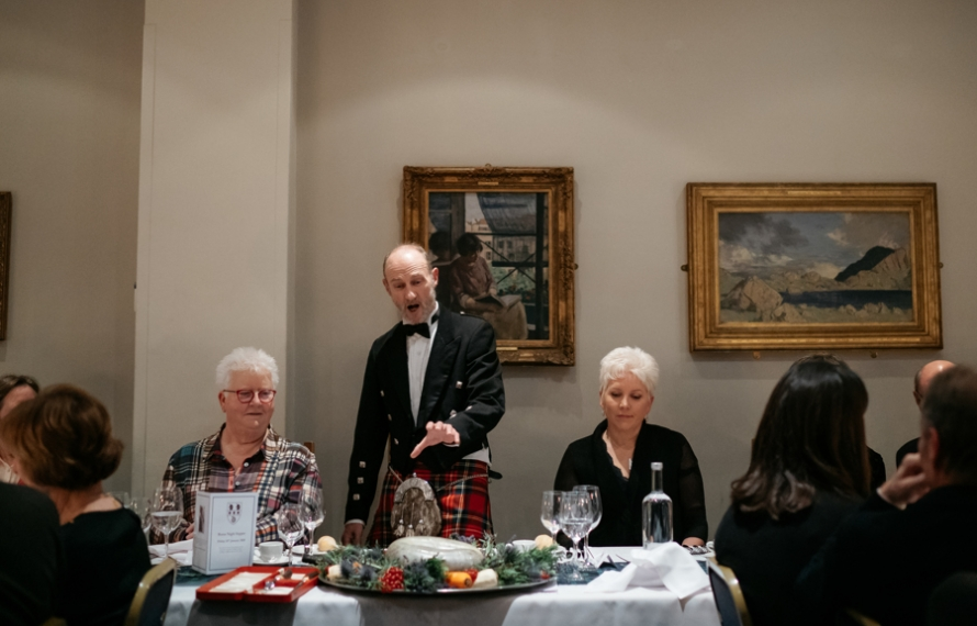 Addressing the haggis on Burns Night at St Hilda's College