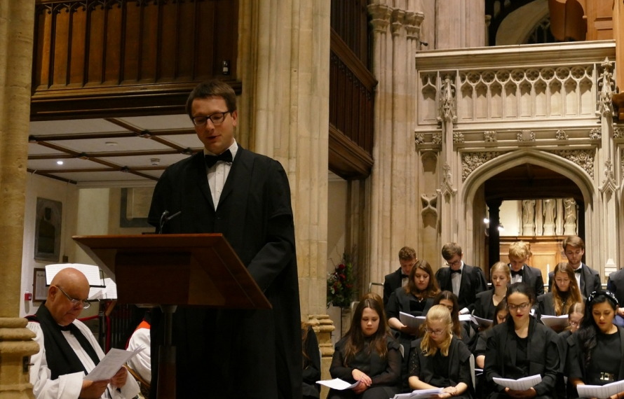 Johannes Ungerer, Lecturer in Law, reads the College prayer at St Hilda's College's Founder's Day Service