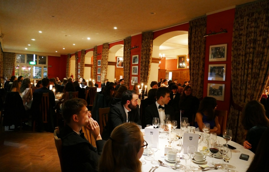 St Hilda's College's members at the Founder's Day dinner listen to the after-dinner speech by Mitchell Harris