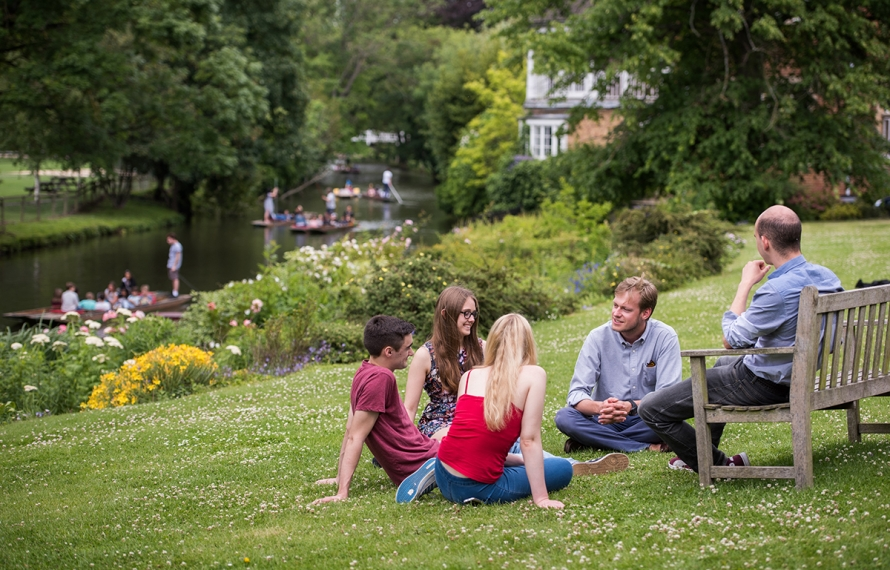 Living in College: Students enjoying the riverside grounds of St Hilda's College