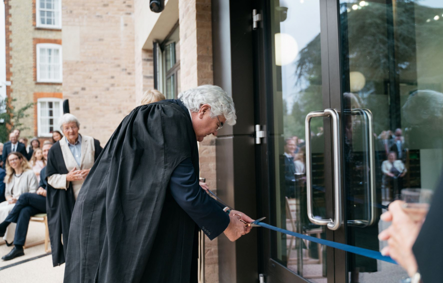 Sir Gordon Duff cuts the ribbon to officially open St Hilda's new buildings